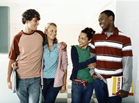 group of students embracing and laughing